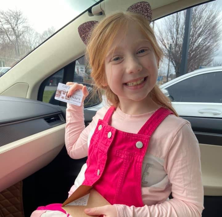 8 yr old Emma of Morristown holding her first giftcard from rosies trattoria