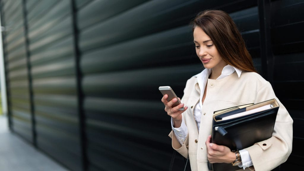 Why Mobile-friendly design is crucial for your business woman on smartphone