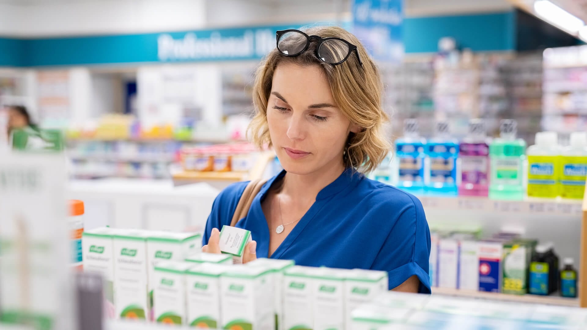 Ensure Your Product Packaging Stands Out woman reading packaging