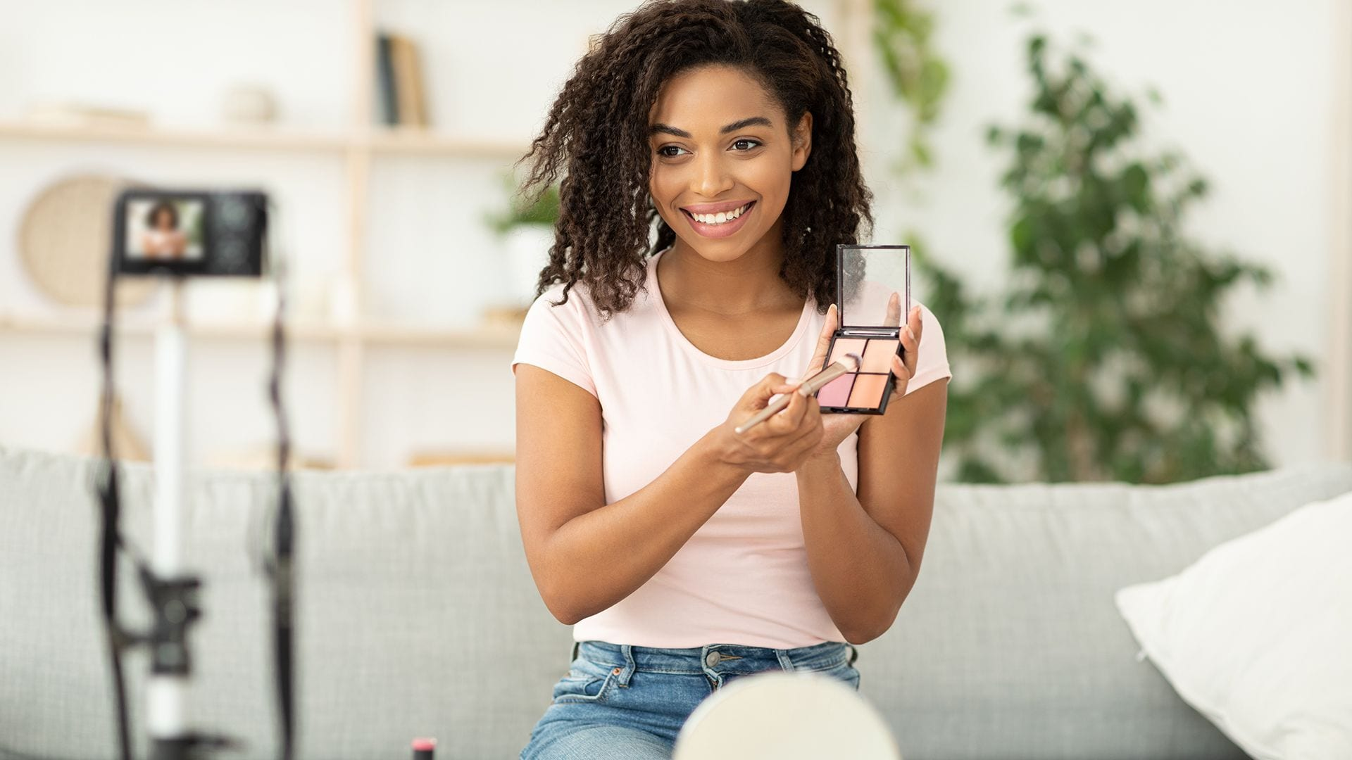 4 reasons why PR is crucial. Woman reviewing makeup that was sent to her by company to show that PR allows for direct contact with customers.